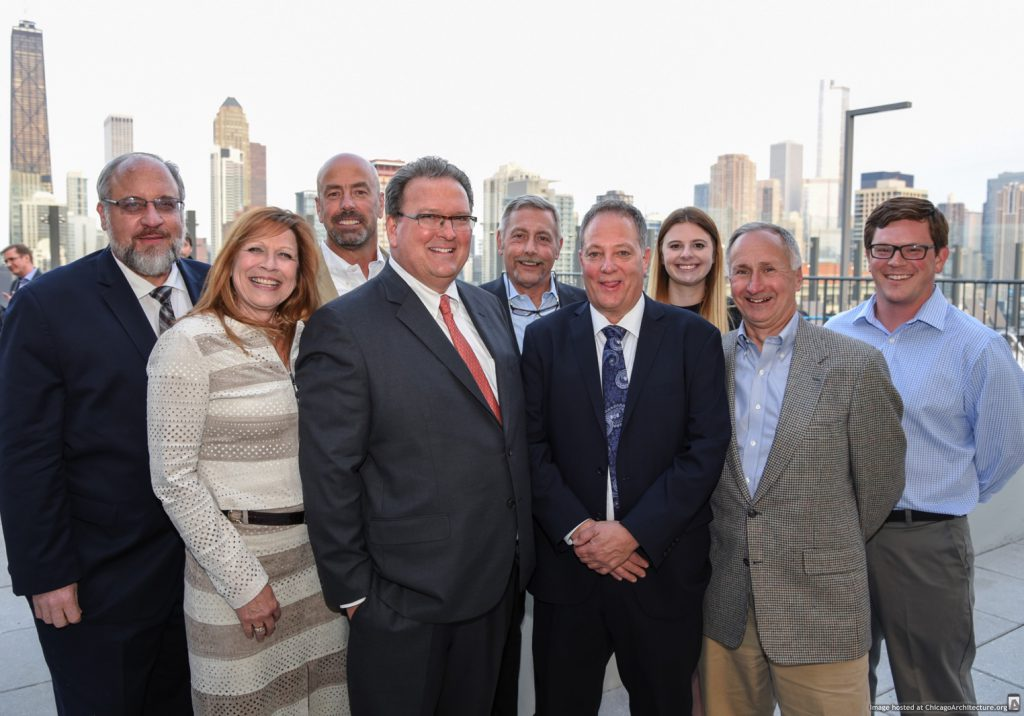 Executives from Ascend Real Estate Group celebrate the grand opening of Niche 905, an 18-story, 202-unit luxury apartment tower on Chicago's Near North Side. (Courtesy of Ascend Real Estate Group)